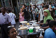 YANGON, MYANMAR - SEPTEMBER 18, 2012.Crowd gather at market in Yangon, Myanmar on Sep 18, 2012. .After nearly five decades where the military had tight control over people's lives, the arrival of democracy has led to debates about a new national identity for the country..(Photo by Kuni Takahashi).
