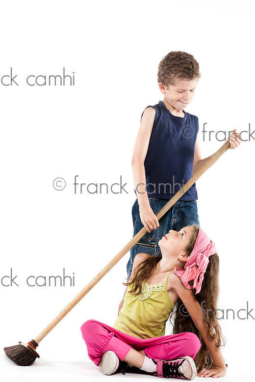 caucasian little boy sweeping angry little girl isolated studio on white background  jealousy concept