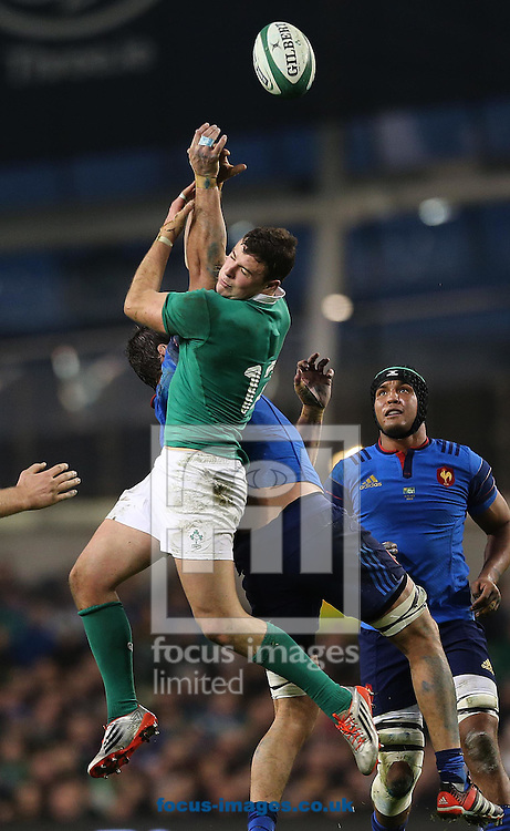 Robbie Henshaw of Ireland gathers under pressure during the RBS 6 Nations match at the Aviva Stadium, Dublin<br /> Picture by Lorraine O'Sullivan/Focus Images Ltd +353 872341584<br /> 14/02/2015