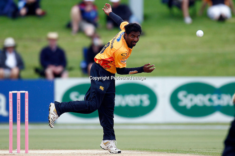 Muttiah Muraliduran bowls in the rain during the HRV Cup match between the Northern Knight v Wellington Firebirds. Men's domestic one day cricket. Blake Park, Mt Maunganui, New Zealand. 4 January 2012. Ella Brockelsby / photosport.co.nz