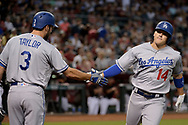 Apr 22, 2017; Phoenix, AZ, USA; Los Angeles Dodgers shortstop Enrique Hernandez (14) is congratulated by teammate Chris Taylor (3) after hitting a solo homer in the first inning against the Arizona Diamondbacks at Chase Field. Mandatory Credit: Jennifer Stewart-USA TODAY Sports