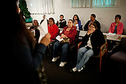 Residents listen during a meeting of the Parklawn United Neighbors in Modesto, Calif., March 1, 2012.