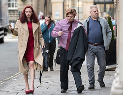 """© Licensed to London News Pictures; FILE PICTURE dated 11/03/2020 of LAURA HAWKINS (beige coat) and JAMES TOOGOOD (pink shirt) arriving at Bristol Crown Court. They have today 23/03/2020 been jailed for 15 months and eight and a half years respectively. JAMES TOOGOOD, age 36 has been jailed for eight and a half years at Bristol Crown Court having been found guilty damaging property being reckless as to whether life was endangered when there was an explosion which caused £260,000 worth of damage to a house in Whitchurch Lane, Bristol. James Toogood, who has 14 previous convictions including robbery, was using butane to make a powerful cannabis derivative known as """"shatter"""". He was remanded in custody until sentencing on Monday. Toogood had admitted producing butane hash oil but said he was not doing so on February 23 2019, the date when there was an explosion at the house he was living in, a council flat at 264 Whitchurch Lane. Laura Hawkins, 39, was jailed for 15 months having been found guilty of permitting a property to be used for the production of a controlled drug of Class B. At the house explosion in Whitchurch Lane, three people received minor injuries and were taken to hospital and much of the house was destroyed. A large trampoline was used to help some people escape. Photo credit: Simon Chapman/LNP."""