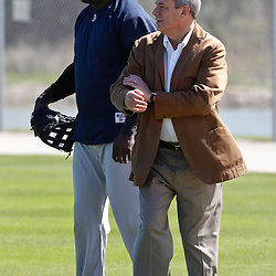 February 19, 2011; Fort Myers, FL, USA; Boston Red Sox first baseman David Ortiz (34) talks with owner Larry Lucchino during spring training at the Player Development Complex.  Mandatory Credit: Derick E. Hingle