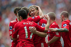 LIVERPOOL, ENGLAND - Saturday, April 23, 2011: Liverpool's Dirk Kuyt celebrates scoring his side's second goal against Birmingham City with team-mates during the Premiership match at Anfield. (Photo by David Rawcliffe/Propaganda)
