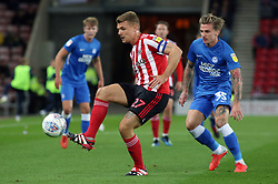 Max Power of Sunderland is put under pressure from Jason Cummings of Peterborough United - Mandatory by-line: Joe Dent/JMP - 02/10/2018 - FOOTBALL - Stadium of Light - Sunderland, England - Sunderland v Peterborough United - Sky Bet League One