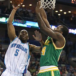 Feb 17, 2010; New Orleans, LA, USA; New Orleans Hornets guard Marcus Thornton (5) shoots over Utah Jazz forward Paul Millsap (24) during the first quarter at the New Orleans Arena. Mandatory Credit: Derick E. Hingle-US PRESSWIRE