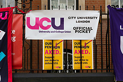 © Licensed to London News Pictures. 23/02/2018. London, UK. Banners of the University and College Union (UCU) at a strike protest over pensions outside City University in London. City University is one of two universities that have warned lecturers they will be partly responsible for student failures and could face legal action if they strike. Photo credit: Vickie Flores/LNP