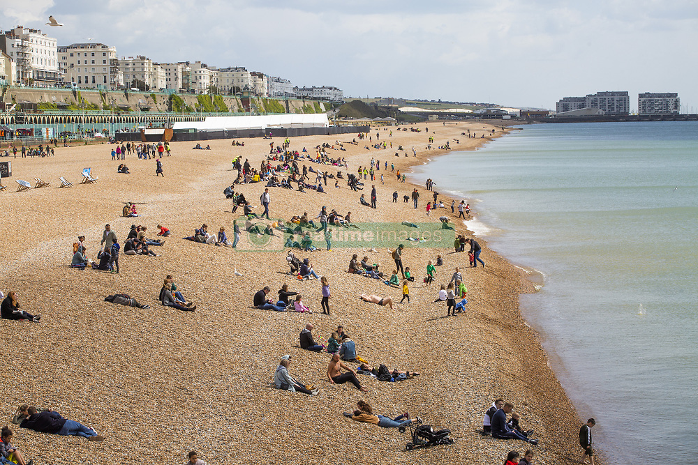 May 4, 2019 - Brighton, East Sussex, United Kingdom - Brighton, UK. A handful of visitors can be seen enjoying the sunshine on the beach in Brighton and Hove as colder weather is hitting the seaside resort on the 2019 May Bank holiday Saturday. (Credit Image: © Hugo Michiels/London News Pictures via ZUMA Wire)