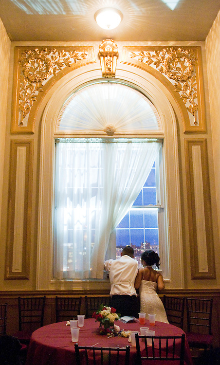 (staff photo by Matt Roth)..Dulaney senior Jessica Peang, right, and her date Alex Chung, a Howard Community College student, have a romantic moment looking at a bird's eye view of Baltimore during Dulaney High School's senior prom held at the Belvedere Hotel's grand ballroom Friday night May 23, 2008.