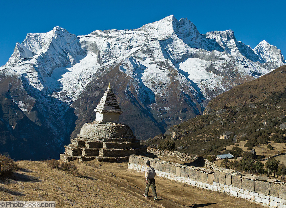 Sagarmatha National Park, Nepal: This mani stone wall and chorten, or stupa, are located above the village of Namche Bazaar, about 4 kilometers from the snowy mountain of Kongde Ri (sometimes called Kwangde Ri; 20,320 feet elevation) in the Himalaya of eastern Nepal. Sagarmatha National Park was created in 1976 and honored as a UNESCO World Heritage Site in 1979.