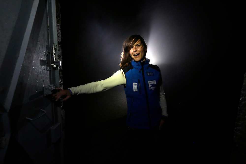 Valentina Futac, of Via Dinarica team entering Vosac mountain hut 1422, on a misty, windy night, Biokovo mountain, Croatia.