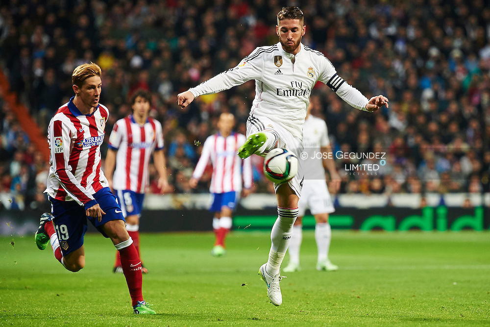 Fernando Torres and Sergio Ramos during the Copa del Rey, round of 8 match between Real Madrid and Atletico de Madrid at Estadio Santiago Bernabeu on January 15, 2015 in Madrid, Spain.