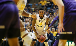 Feb 12, 2018; Morgantown, WV, USA; West Virginia Mountaineers guard Daxter Miles Jr. (4) holds the ball during the second half against the TCU Horned Frogs at WVU Coliseum. Mandatory Credit: Ben Queen-USA TODAY Sports