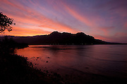 Photograph of a dramatic sunset sky over Kahana Bay, Oahu, Hawaii