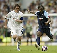 Photo: Aidan Ellis.<br /> Leeds United v Swansea City. Coca Cola League 1. 22/09/2007.<br /> Leeds Johnathon Douglas (L) and Swansea's Jason Scotland