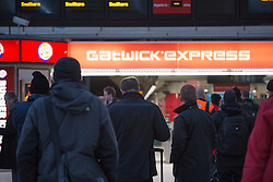 © licensed to London News Pictures. London, UK 17/01/2013. Passengers to Gatwick Airport waiting for services to continue after a Gatwick Express train catches fire in Victoria Station during the rush hour and causing the station closure. Photo credit: Tolga Akmen/LNP
