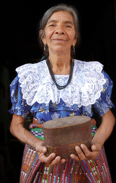 8/5/03  Photo by Mara Lavitt--Ana &amp; box<br /> #0446<br /> San Juan la Laguna midwife Ana Toc de Ramos age 63 holds the wooden box within which can be found the remnants of her amniotic membrane which denotes her special calling to midwifery.