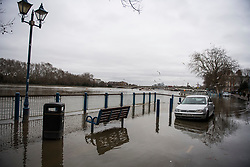 © Licensed to London News Pictures. 01/01/2018. London, UK. Flood water covers the roads along the embankment at Putney in West London where the River Thames has broken it's banks. Photo credit: Ben Cawthra/LNP