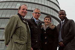 © Licensed to London News Pictures.05/04/2012. London, UK. The Lib Dem mayor of London candidate Brian Paddick  (centre) pictured outside City Hall today (05/04) with Caroline Pigeon (right centre) and Simon Hughes MP (far left) to announce that if elected Dwayne Brooks (right) would become deputy mayor for youth and community. Photo credit : James Gourley/LNP