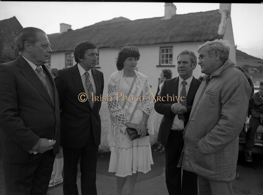 "The Carlingford Oyster Festival.1982.19.08.1982..08.19.1982.19th August 1982..Pictures and Images of the Carlingford Oyster Festival... The Minister For Fisheries and Forestry Mr Brendan Daly officially opened  The Carlingford Oyster Festival. The Chairman of the organising committee was Mr. Joe McKevitt..""The Oyster Pearl"" was Ms Deirdre McGrath..The Minister accompanied by the ""Oyster Pearl"", Ms McGrath  meet some of the organising committee."