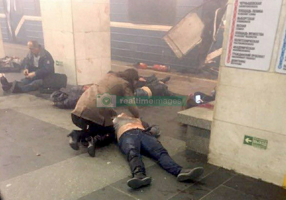 April 3, 2017  - St Petersburg, Russia - The scene immediately after the blast with people on the ground at Sennaya metro station in St. Petersburg. A suspected bomb detonated on a metro train in St Petersburg on Monday, killing at least 10 people. The blast occurred at the Sennaya Ploshchad station, in the centre of Russia's second city, at about 2.30pm, reportedly as the train was pulling out of the station. (Credit Image: © Russian Look via ZUMA Wire)