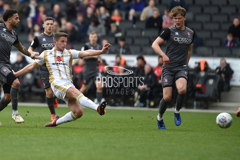 Milton Keynes Dons midfielder (on loan from Chelsea) Jordan Houghton (24) takes a shot at goal during the EFL Sky Bet League 2 match between Milton Keynes Dons and Lincoln City at stadium:mk, Milton Keynes, England on 6 April 2019.