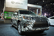 "Manhattan, New York, USA. April 12, 2017.  2017 Lexus SUV with exterior, covered in pattern by fashion designer Zang Toi is on display at the New York International Auto Show, NYIAS, during the first Press Day at the Javits Center. About two Press Conferences were held each hour at the annual event ""Where the auto industry gathers to unveil the future."""
