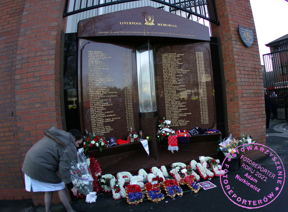 Flowers are laid at the memorial for the Liverpool fans killed at Hillsbrough outside Anfield stadium
