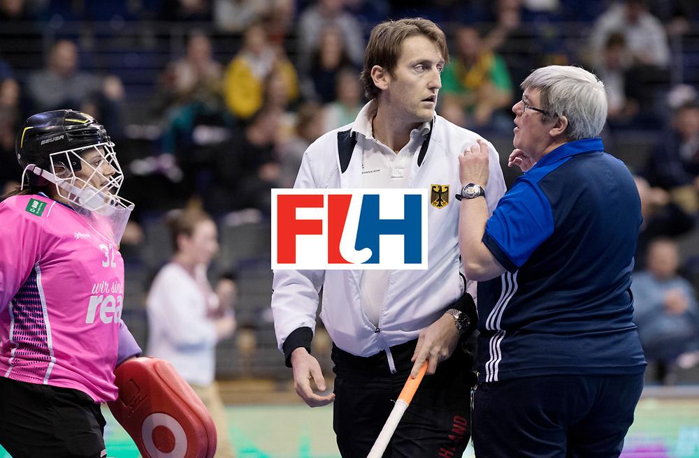 BERLIN - Indoor Hockey World Cup<br /> Women: Germany  - Australia<br /> foto: Rosa Kruger and Xavier Reckinger fighting with an FIH official.<br /> WORLDSPORTPICS COPYRIGHT FRANK UIJLENBROEK