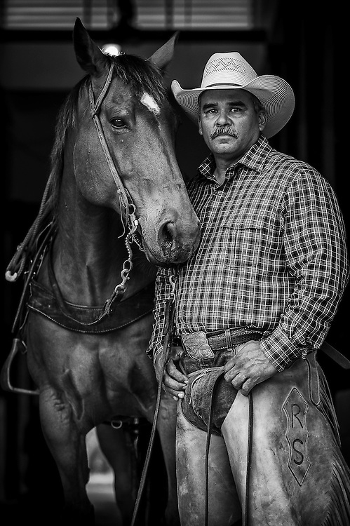 Cowboy Robert Silguero of the King Ranch with his horse 'Signs'