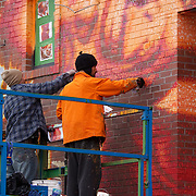 Graffiti artists painting wall mural, Montreal, Quebec, Canada