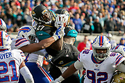 Jacksonville Jaguars running back Leonard Fournette (27) is stopped by the Buffalo Bills defense on the goal line on third down during the second half of an NFL wild-card playoff football game, Sunday, Jan. 7, 2018, in Jacksonville, Fla. Jaguars beat the Bills 10-3. (AP Photo/Stephen B. Morton)