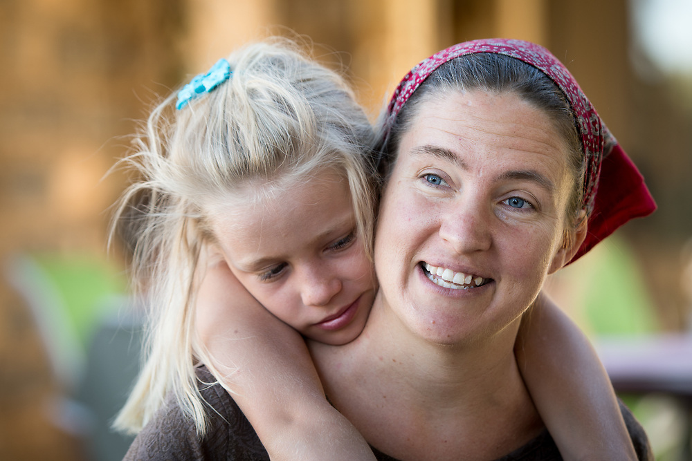 Daughter embracing her mother on Dabis Guest Farm in Helmeringhausen, southern Namibia, Africa.