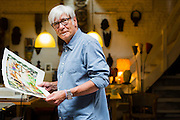 Brussels, Belgium 29 August 2014. Johan De Moor, famous Belgian cartoonist and son of Bob De Moor, right hand of Tintin's Hergé in his studio with a cartoon he made on Brussels. © Sander de Wilde pour M le magazine du Monde