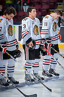 KELOWNA, CANADA - OCTOBER 4:  Ethan Price #3 of the Portland Winterhawks stands on the ice during the national anthem  at the Kelowna Rockets on October 4, 2013 at Prospera Place in Kelowna, British Columbia, Canada (Photo by Marissa Baecker/Shoot the Breeze) *** Local Caption ***