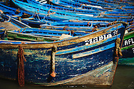 The colorful blue fishing rowboats at the Essaouira harbor