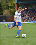 Bury Defender Joe Riley unleashes a cross into the rochdale box during the Sky Bet League 1 match between Bury and Rochdale at Gigg Lane, Bury, England on 17 October 2015. Photo by Mark Pollitt.