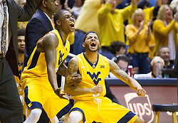 Jan 24, 2017; Morgantown, WV, USA; West Virginia Mountaineers guard Teyvon Myers (0) and West Virginia Mountaineers guard James Bolden (3) celebrate late in the second half against the Kansas Jayhawks at WVU Coliseum. Mandatory Credit: Ben Queen-USA TODAY Sports