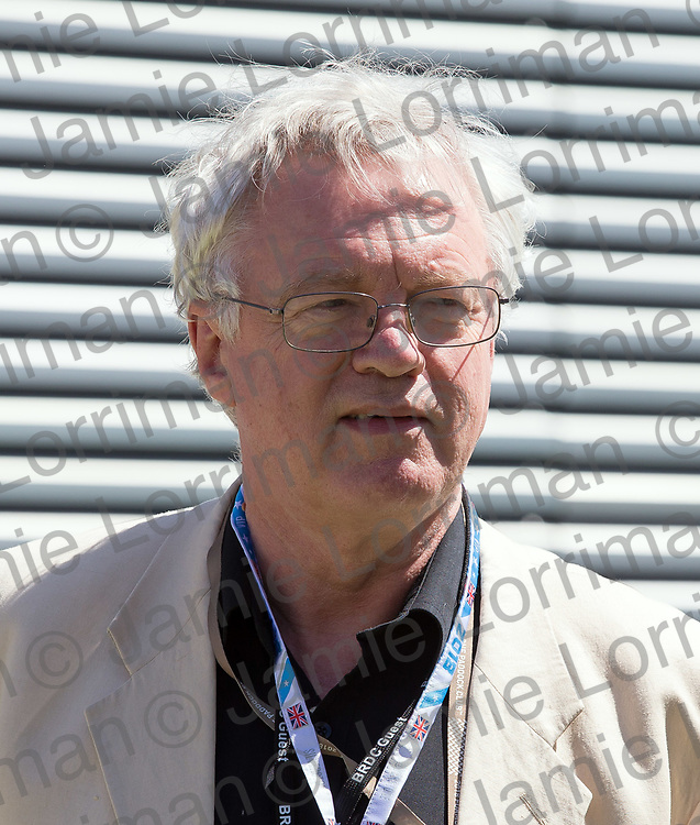 The 2018 Formula 1 F1 Rolex British grand prix, Silverstone, England. Sunday 8th July 2018.<br /> <br /> Pictured: David Davis MP, Secretary of State for Exiting the European Union, walks through the paddock ahead of the race at Silverstone.<br /> <br /> Jamie Lorriman<br /> mail@jamielorriman.co.uk<br /> www.jamielorriman.co.uk<br /> 07718 900288