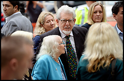 Artist and television personality Rolf Harris arrives with his wife Alwen Hughes and their daughter with their daughter Bindi at The City of Westminster Magistrates Court, London, England. Mr Harris, who was arrested in March by police officers working for Operation Yewtree, has been charged with nine counts of indecent assault on teenage girls and four counts of making indecent images of children, United Kingdom. Monday, 23rd September 2013. Picture by Andrew Parsons / i-Images<br />