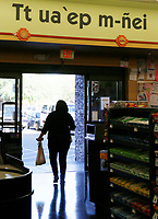 "A customer leaves the grocery store on the Tohono O'odham Nation reservation under a sign that reads ""we will see you again"" in the O'odham language in Sells, Arizona April 6, 2017. Picture taken April 6, 2017.  REUTERS/Rick Wilking"
