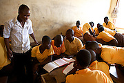 Elisha Ayibasiya teaching his class in groups at Tonga Junior High School, Ghana.