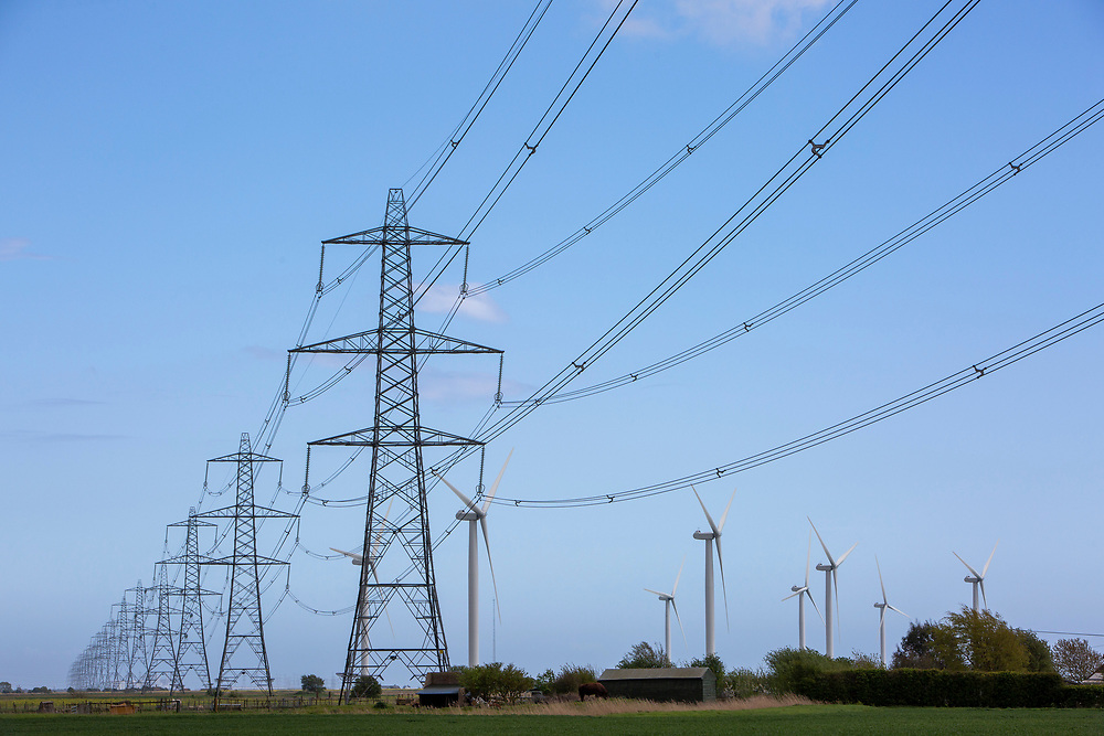 Electrical pylons running from Dungeness alongside the Little Cheyne Court Wind Farm on Romney Marsh, Kent, United Kingdom.  (photo by Andrew Aitchison / In pictures via Getty Images)