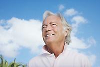 Portrait of senior man against sky smiling