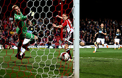 Lasse Vibe of Brentford scores his second and his sides third goal past Ben Amos of Bolton Wanderers - Mandatory by-line: Robbie Stephenson/JMP - 05/04/2016 - FOOTBALL - Griffin Park - Brentford, England - Brentford v Bolton Wanderers - Sky Bet Championship