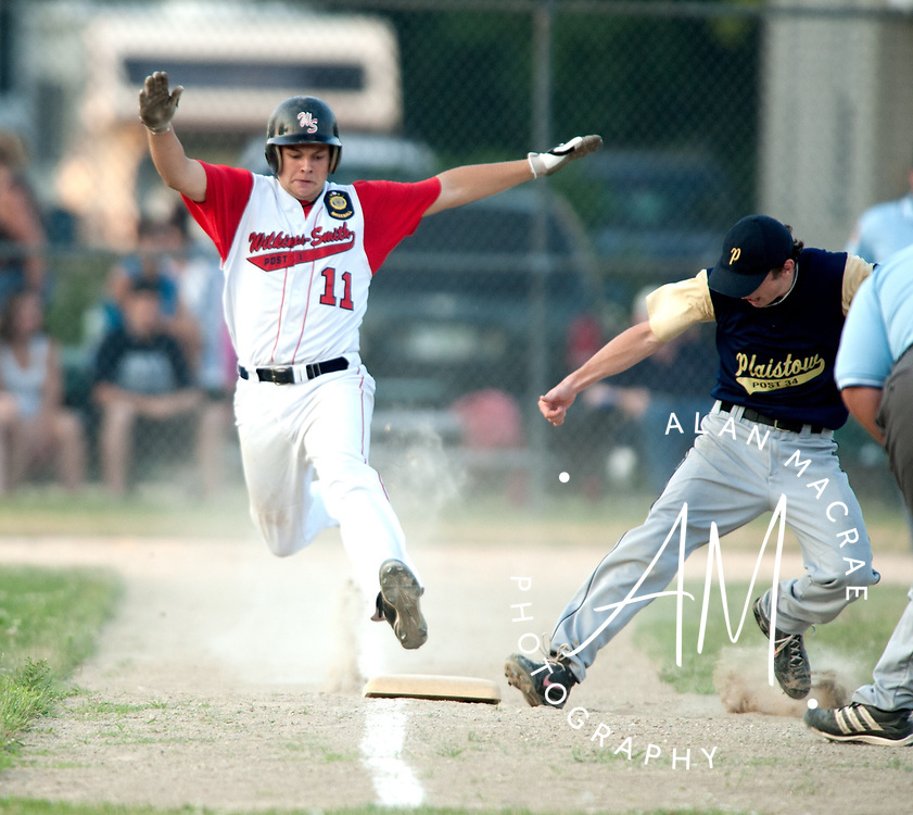 Laconia's Hunter Jenson tries to make it to first ahead of Plaistow first baseman [10-J. Faia] in Monday's game at Laconia's Memorial Park.  (Alan MacRae/for the Citizen)