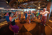 Aboard the Rhapsody of the Seas, on a cruise from Vancouver to Hawaii. Shall We Dance Lounge. Spirit of Polynesia Performance. Passengers learning the Hula.
