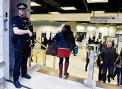 © London News Pictures. 24/03/2016. London, UK. Armed police officers patrol Liverpool Street Station during rush hour, just days after the Belgian capital was hit by a terrorist attack. Photo credit : Hannah McKay/LNP