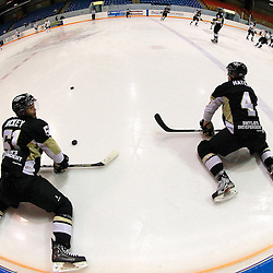 NEWMARKET, ON - Feb 20 : Ontario Junior Hockey League Game Action between the Trenton Golden Hawks and the Newmarket Hurricanes, Shaquille Hickey #51 of the Trenton Golden Hawks Hockey Club and Tyler Mayea #4 of the Trenton Golden Hawks Hockey Club stretch during warmup.<br /> (Photo by Brian Watts / OJHL Images)